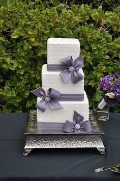 Purple ribbon wedding cake. For more ideas visit www.diybudgetweddings.com