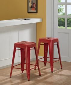@Overstock - A contoured seat is featured on this set of two side chairs for comfort and style. This chair set comes in a red color with a powdercoat finish.http://www.overstock.com/Home-Garden/Tabouret-24-inch-Red-Metal-Counter-Stools-Set-of-2/5095629/product.html?CID=214117 $82.99