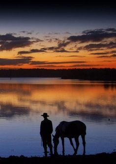 Cowboy and his Dearest Companion, at the End of the Day enjoying a Sunset and a Drink