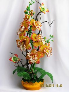 Oksana Konovalova bead artist from Ukraine. She makes amazing and creative beaded floral compositions