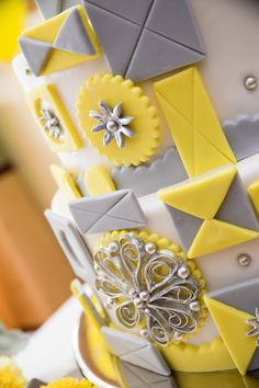 Detail of a yellow and gray It's a Small World cake at a Disney wedding