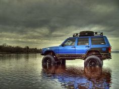 Lifted Blue XJ Jeep. I like when guys lift their cherokee, no matter how old, always sexy