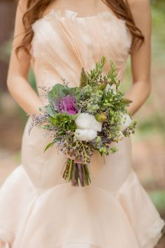 Bouquet Ideas - Ideal for your next woodland wedding, this bouquet has pale pink and purple flowers surrounded by lush greenery and cotton. Wrap with twine to add a vintage, rustic touch.