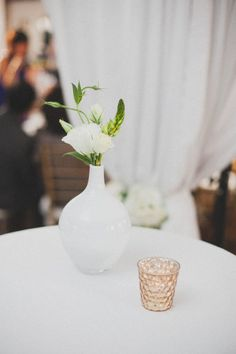 Floral table top decorations… little white vases
