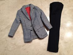 1964 Ken doll Country Clubbin #1400, black and white houndstooth jacket with red half lining and zippered black slacks. One of the 2 tiny black