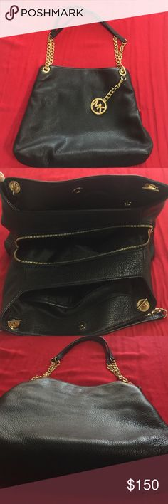 Michael kors black handbag Black Michael Kors Hannah with gold detail including gold chain straps. Purse has 3 compartments. I bought it last fall and used it 3 times. It has no visible wear, flaws or markings inside or out. Michael Kors Bags Shoulder Bags