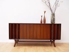 I'm a huge fan of mid century modern design and I ran across this piece. Mid-century Zenith stereo console made of SOLID walnut. Stereo Cabinet, Console Cabinet, Wooden Console, Sideboard, Radios, Record Player Console, Record Players, Vintage Stereo Console, Mid Century Credenza