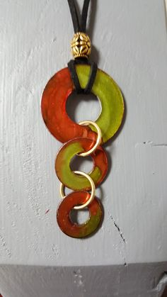 Triple washer pendant with alcohol ink, connected by jump rings, on cording finished with a bead