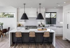 Black and white kitchen design ideas with contemporary, modern, farmhouse, traditional and rustic cabinets & finishes. Black Kitchen Island, Black Kitchen Cabinets, Kitchen Cabinet Styles, Rustic Cabinets, White Cabinets, Kitchen Island Finishes, Kitchen Taps, Kitchen Islands, Modern Farmhouse Kitchens