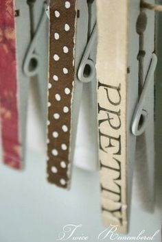clothespins decorated with scrapbook paper - use as magnets