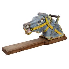 Vintage Cast Iron Horse Head See-saw Handle  USA  early 20th century  A heavy cast iron handle from a see saw in the form of a horse. The piece retains its original paint in places and has been mounted to a wooden base.