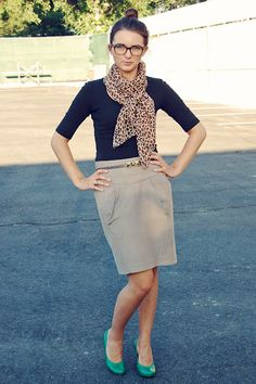 Beige skirt, black top and animal/cheetah print scarf