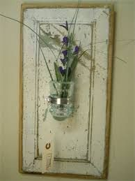 Image result for decorating with glass insulators