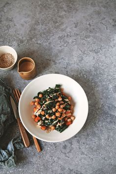 So quick and easy, this flavor-packed, smoky kale and chickpea stir-fry with miso peanut sauce is great served alone. It's also a perfect match with roasted sweet potatoes to make for a colorful complete meal. While definitely good for you, this dish is quite a treat too. Vegan, gluten-free. via @runonrealfood