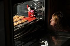 Elf on the Shelf 2010 (Fizzy): 12.08: She was so excited to see that Fizzy baked cookies for us! She kept sampling the sprinkles.
