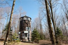 Tall, round, wood house for sale near Woodstock for $163K -