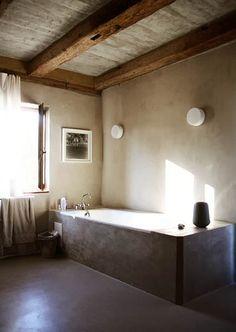 Tones of brown + gray in a modern + homey bathroom