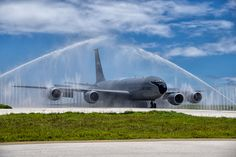 A KC-135 Stratotanker taxis through the wash rack, also known as a bird bath, after a mission Aug. 18, 2014. The KC-135 is assigned to the Tennessee Air National Guard's 134th Air Refueling Wing. (Air National Guard photo by TSgt. Jonathan Young)