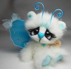 Starlight By Michelle Nunnery - A mini plush butterfly bear.The blue in her wings and her antennas are aqua, they look a little more blue than the really areShe has premium quality glass eyes. Eyes have eyelashes.Arms and legs jointed with string.Head is jointed with cotter pin and...