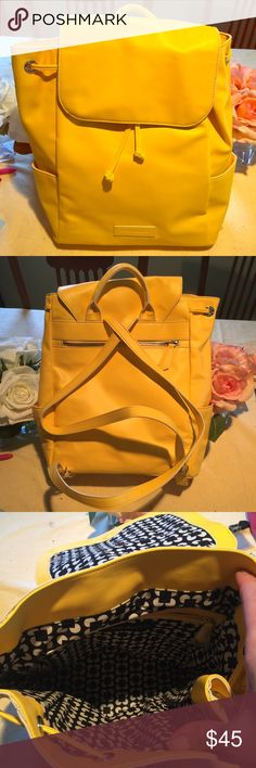 Vera Bradley Faux leather backpack Bright yellow used faux leather backpack.  Has a pocket on each side and zip pocket in the back.  The top flap has a magnetic and drawstring closure.  The inside has a black and white cotton lining with a zippered side pocket.  The bag was lightly used and is in good shape. Comes from a smoke free home. Vera Bradley Bags Backpacks