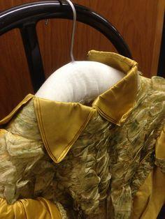Unusual triangular shaped cut out collar