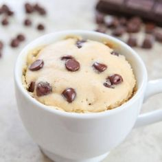 This single serving microwave chocolate chip mug cake starts with a fluffy brown sugar cake base mixed with chocolate chips. It cooks in just 1 minute and tastes like a chocolate chip cookie that got turned into a cake. Easy Microwave Recipes, Mug Cake Microwave, Microwave Cookies, Individual Desserts, Easy Desserts, Dessert Recipes, Quick Dessert, Chocolate Chip Mug Cake, Chocolate Mug Cakes