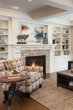 ***stone fireplace for family room*** White living room built-ins with stacked stone fireplace. Such a cozy room and great tips on how to refresh your space in the new year! White Fireplace Surround, Fireplace Built Ins, Fireplace Remodel, Fireplace Surrounds, Fireplace Design, Fireplace Modern, Fireplace Ideas, Fireplace Stone, Fireplace With Bookshelves