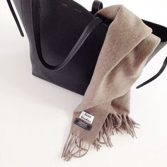 There is nothing as cozy (and chic) as an Acne scarf.