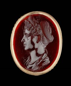 Roman gem portrait. Made of carnelian, the woman depicted is identified as Marciana, older sister of the emperor Trajan by her particular hairstyle. Late…