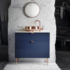 Bathroom Furniture from @modshop1 - loving the textured black cabinetry and rose gold accent! #bathroom #innovative #design #vanity #rosegold #marble #contemporary #black #gorgeous #texture #interiors