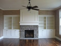 Idea for basement- No fireplace and mount TV on upper center panel. Paint current build-in units white. Danny likes the stone on this fireplace and how fireplace is a different color. Wall Units With Fireplace, Tv Over Fireplace, Fireplace Bookshelves, Fireplace Built Ins, Home Fireplace, Modern Fireplace, Fireplace Design, Fireplace Mantels, Fireplace Ideas
