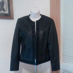 Stunning Leather Jacket... NWT This beautiful leather jacket is new with tags by Chico's! Wear as a jacket or blazer! 100% leather with hook and eye closure. Trimmed with black beading. Size 0. Very classy jacket! Chico's Jackets & Coats Blazers