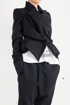 Black tailored jacket by Vivienne Westwood.