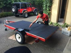 Harbor freight trailer with Deck & Concrete Restore 10x Rust-Oleum textured paint, tinted black. 1 gallon. This is the same trailer used to create teardrop campers.