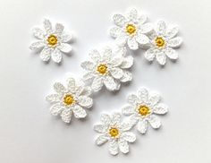 I have crocheted white daisies applique from 100% cotton thread. This listing is for 6 pieces of small flowers with yellow centers. They measure 4,5 cm (1.8 inches). The flowers will be perfect for any DIY project or great as kids party or even Wedding day decorations, gift wrapping ornaments etc. You can also use them: ♥ gift decorations; ♥ party decorations; ♥ cardmaking, scrapbooking; ♥ sew on baby and children clothes; ♥ sew on your hair clips, bags, blankets, pillowcases etc.; ♥…