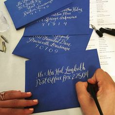 "Hand-mixed cream #letters on these ""blast-off blue"" envelopes for days ✒️ #calligraphy"