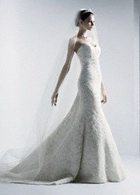 Strapless sweetheart beaded lace trumpet with shirred tulle bodice. Sweep train. Available online in Ivory. Available in stores in Ivory or White (Special order only). *SPECIAL VALUE! Was $1,050.00, Now $750.00! (final selling price; no additional discount may be applied). To preserve your wedding dreams, try our Wedding Gown Preservation Kit.A train that just brushes the floor.A popular neckline for brides seeking a stylish and versatile look (offering unlimited jewelry and accessory…