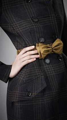 Burberry - nice juxtaposition of the soft bow belt over the tailored wool coat