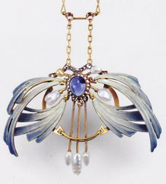 A Jugendstil pendant designed by Georg Kleemann. Composed of gold, sapphire…