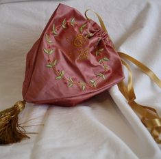 "I've recently made a Regency reticule for a friend, and used your suggestions for period embroidery from the Elegant Lady's Closet to put her monogram on it. My 5yo boy has rated my handiwork as ""that's fantastic mummy"" (who could ask for higher praise). A publication of embroidery patterns from the era would be very … Read more..."