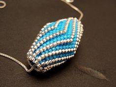 Folded Turquoise and Silver Beaded Bead Pendant by tattooedraven