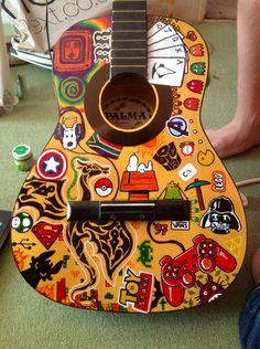Sharpies on a guitar, a project for my brother :) lots of recognisable stuff but the dragon is mine