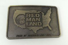 Home of America's best Chew Red Man Land Tobacco Belt Buckle.  - Brass Material  - 3 1/2 inches X 2 inches.  - Back had the double J symbol.  - Center features the United States and an American Indian. #RedMan #Novelty
