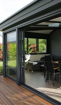 27 Enclosed Patio Ideas For Your Outdoor Space 2019 - A Nest With A Yard black themed veranda with glass enclosure Enclosed Patio, Screened In Patio, Patio Roof, Pergola Patio, Backyard Patio, Pergola Kits, Front Porch, Pergola Ideas, Patio Enclosures