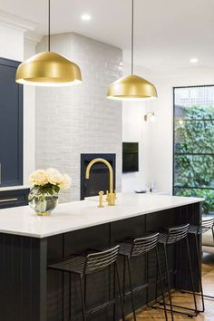 I'm stalking in the Melbourne suburb of Armadale. A renovated Edwardian red brick semi with a m...