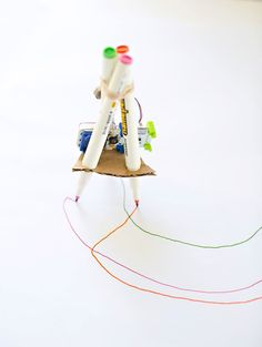 Learn how to make this Xtremely cool DIY Drawing Robot for creative fun with your kids! It's perfect for getting their little engineer minds tinkering!