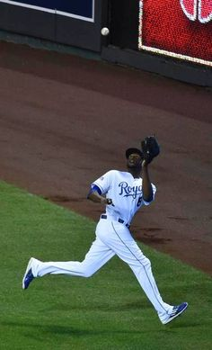 Kansas City Royals center fielder Lorenzo Cain caught a fly ball hit by Baltimore Orioles catcher Nick Hundley in the second inning at Tuesday's ALCS playoff baseball game on October 14, 2014 at Kauffman Stadium in Kansas City, MO.