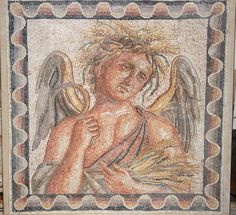 Roman Mosaic Personification of Autumn, 2nd century AD The mosaic depicting a male torso personifying Autumn harvesting grain surrounded by a complete 3-dimensional geometric scallop pattern. Tesserae of cream marble and colored calcites. From the...