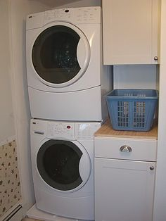 stacked machines in small laundry room. Get cabinets for the side.
