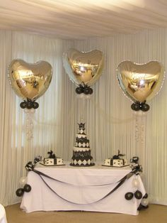Elegant and simple balloon decoration for a wedding cake table.